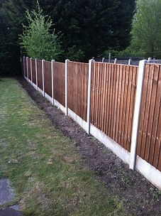 fences installed by our fence installer, new concrete posts erected with plain gravel boards and featherboards