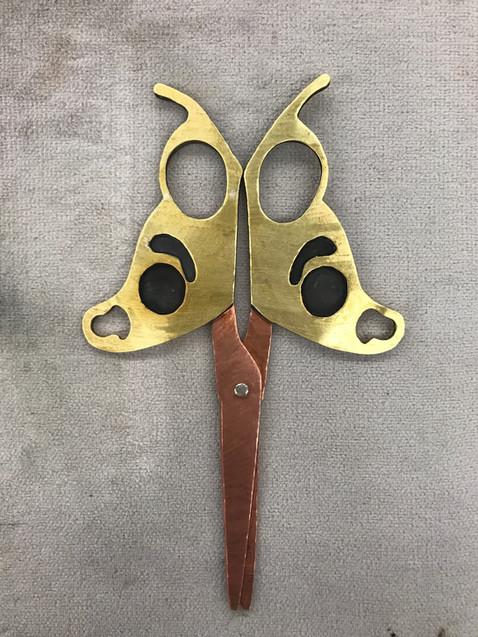Butterfly Scissors Downside