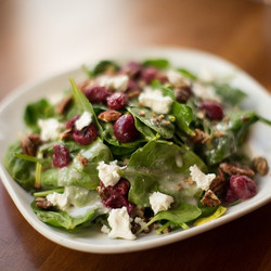 Spinach salad, goat cheese, roasted grapes, candied pecans & mac nut vinaigrette.