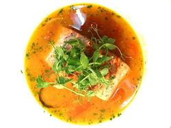 Wild caught Alaskan salmon cioppino with kamuela cherry tomatoes & sweet Maui onions...