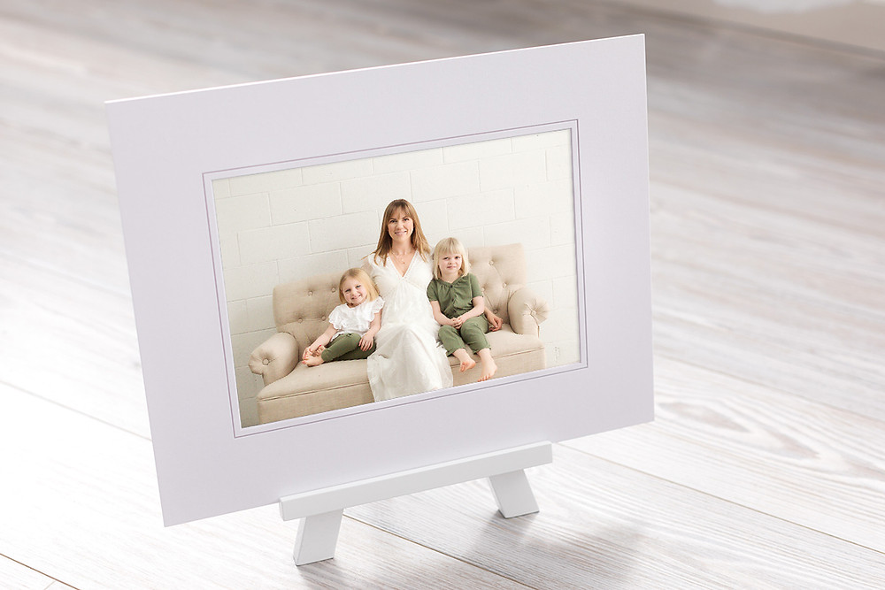 Nicole Hemeon Photography print of mom and kids, wearing client wardrobe, in Kelowna