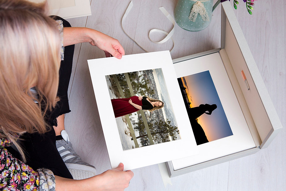 mom holding printed maternity picture with image keepsake box and usb