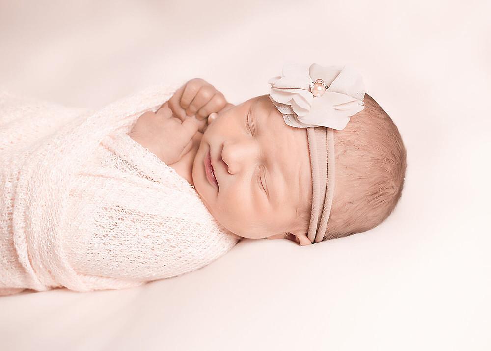 okanagan newborn baby wearing headband wrapped in pink