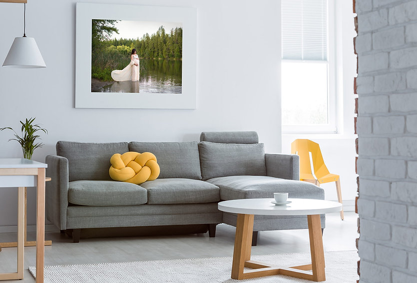 maternity canvas print above grey couch in living room
