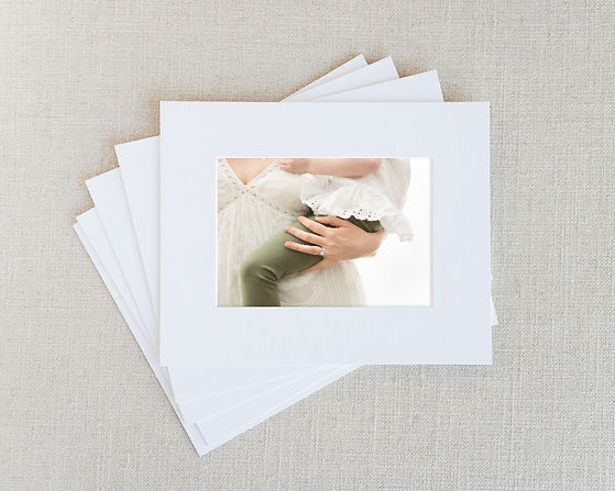 matted photo print of mom's hand holding daughter