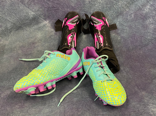 Youth soccer boots and shin guards
