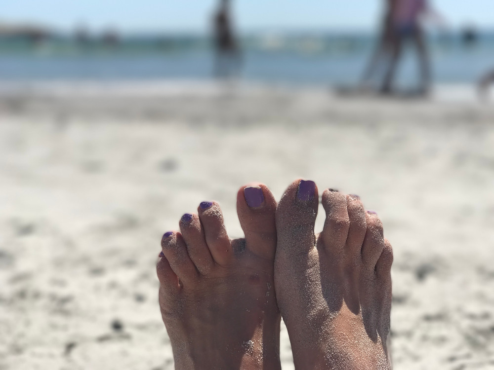 Sandy feet at Reject's Beach