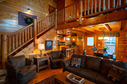 Living room with game loft above