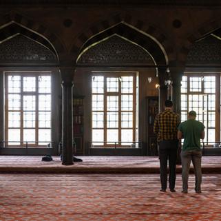 Praying in Blue Mosque, Istanbul, Turkey