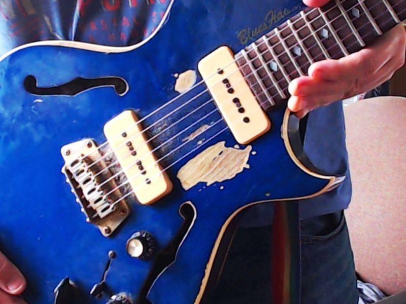 beaten up guitar pick mute