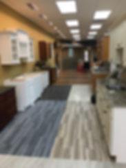 Showroom featuring cabinets,windows,flooring,tile,countertops,granite,marble,windows
