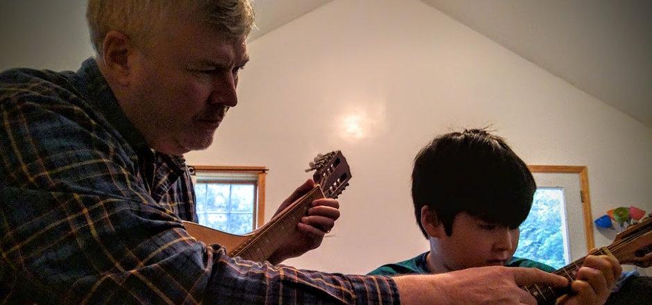 Ricky learning mandolin.jpg