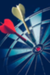 Bullseye is a target of business. Dart is an opportunity and Dartboard is the target and goal.jpg