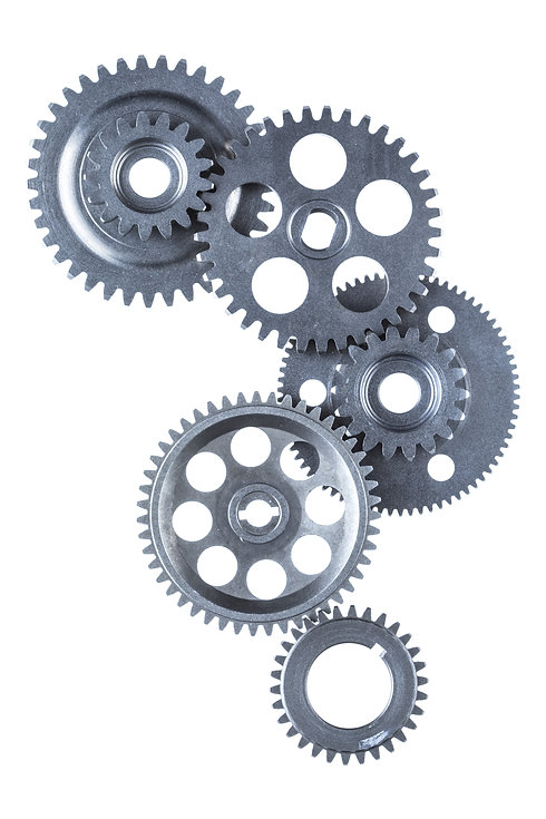 A large group of industrial metal gears are linked together over a white background.jpg