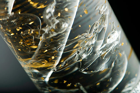 Royal Dragon Vodka gold flakes close up.