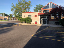 Lansing office entrance and parking lot