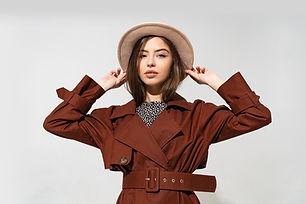 fashionable-woman-brown-coat-beige-hat-p