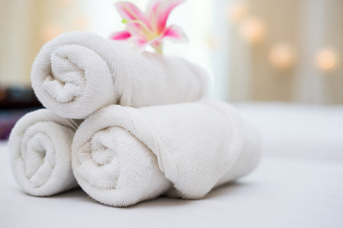 beautiful pink orchid on white towel in