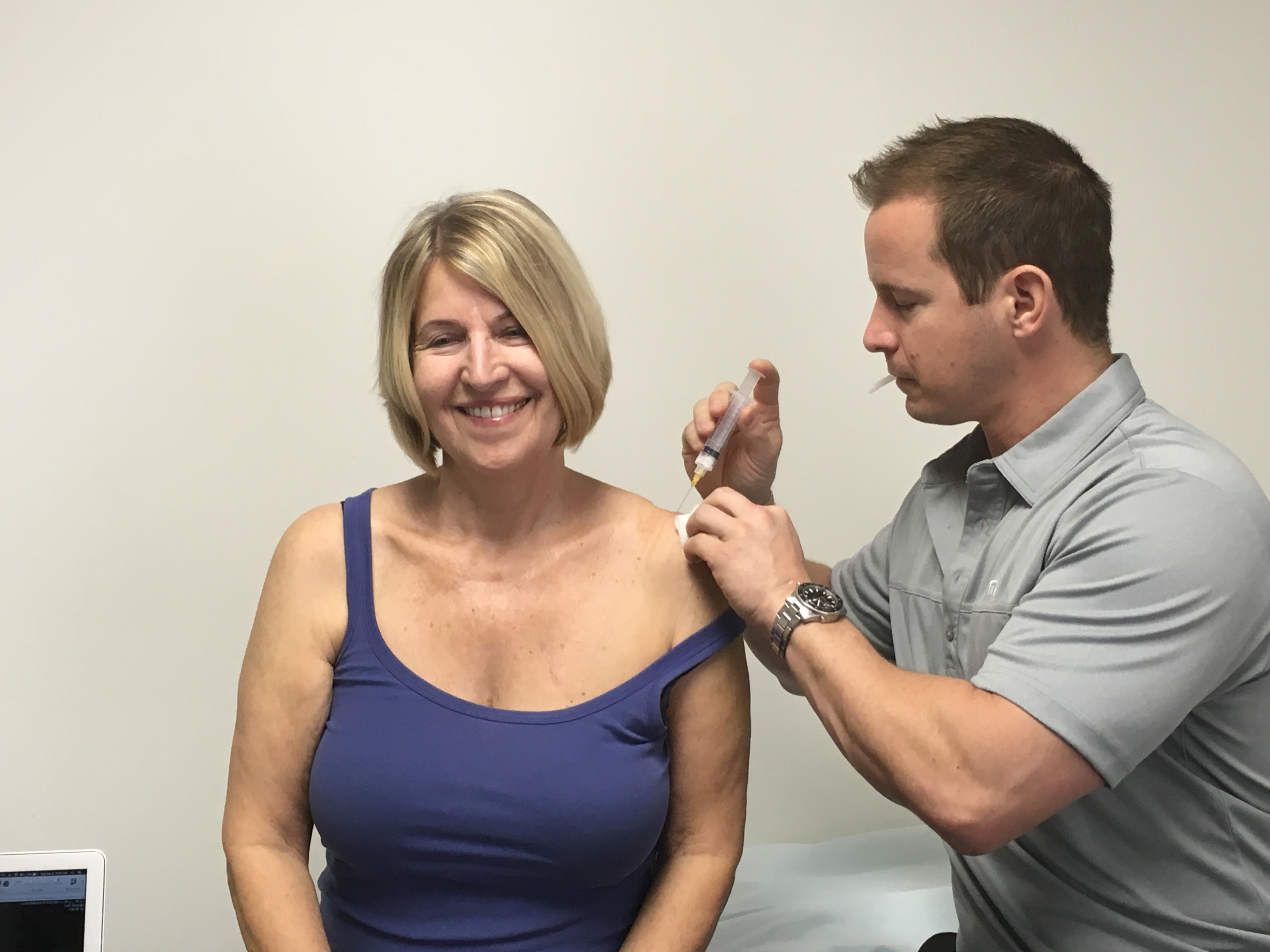 Dr. Hartshorn performs an injection