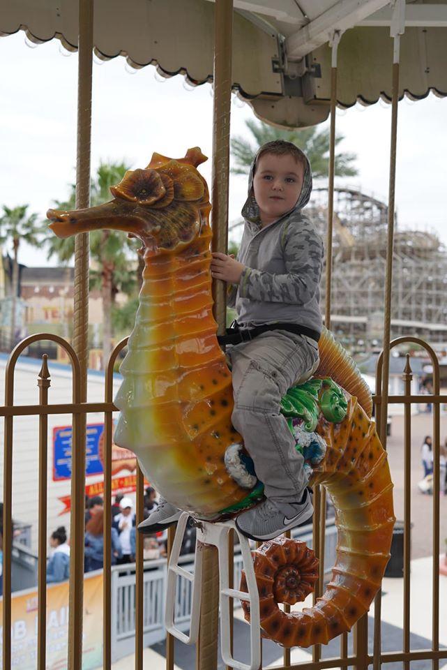 son on ride at Keamh Boardwalk