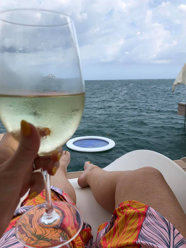 wine in bungalow on water
