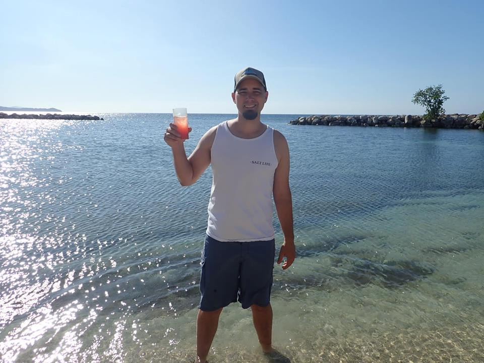 beach with drink at Sunscape Cove in Montego Bay