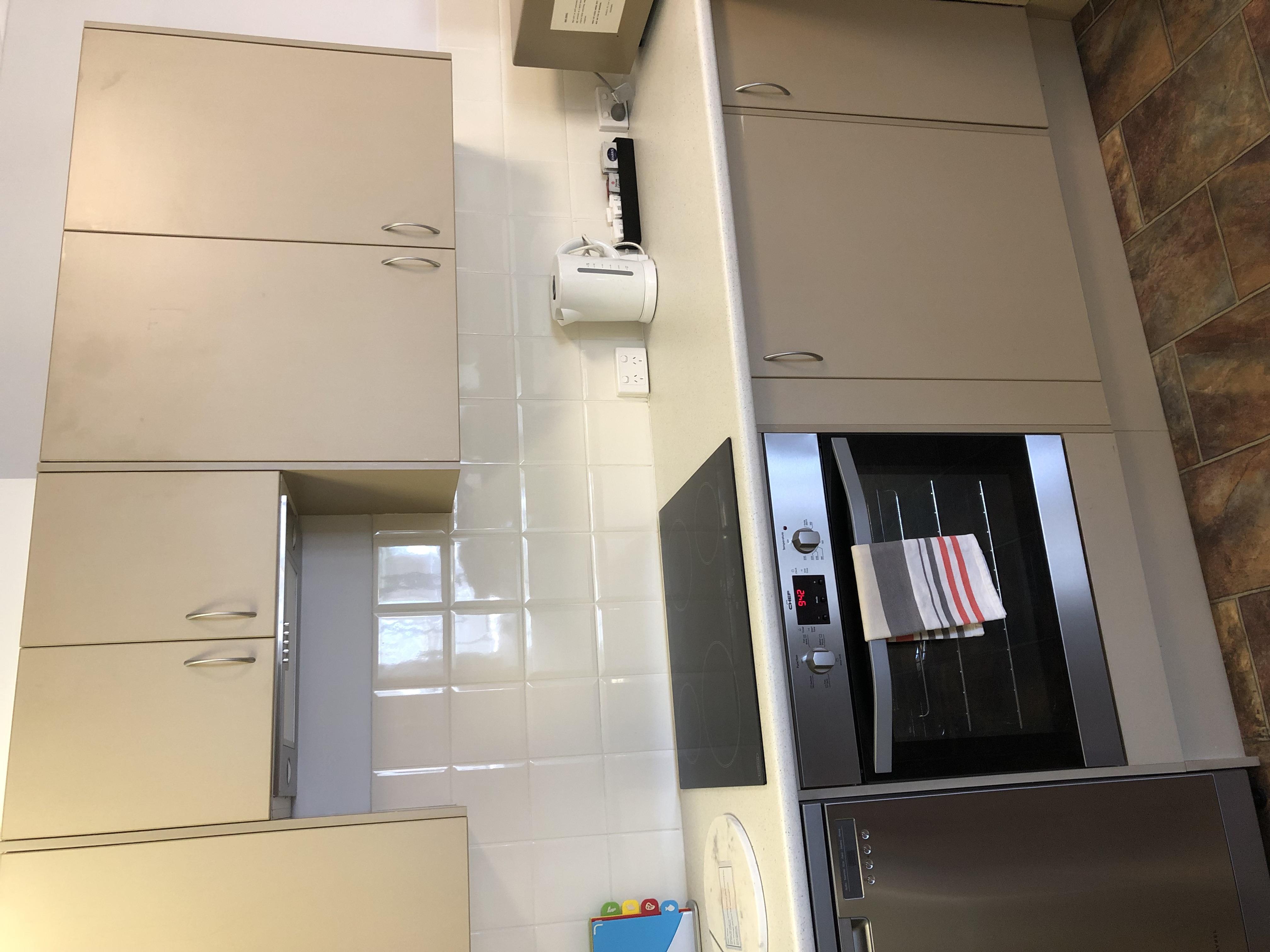 Kitchen with stove, rangehood, oven