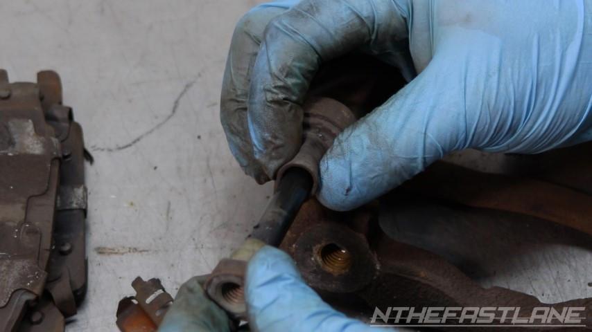 Removing slider bolt pinch and twist