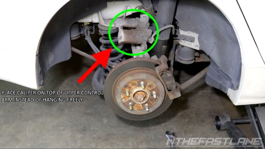Don't hang brake caliper from brake line