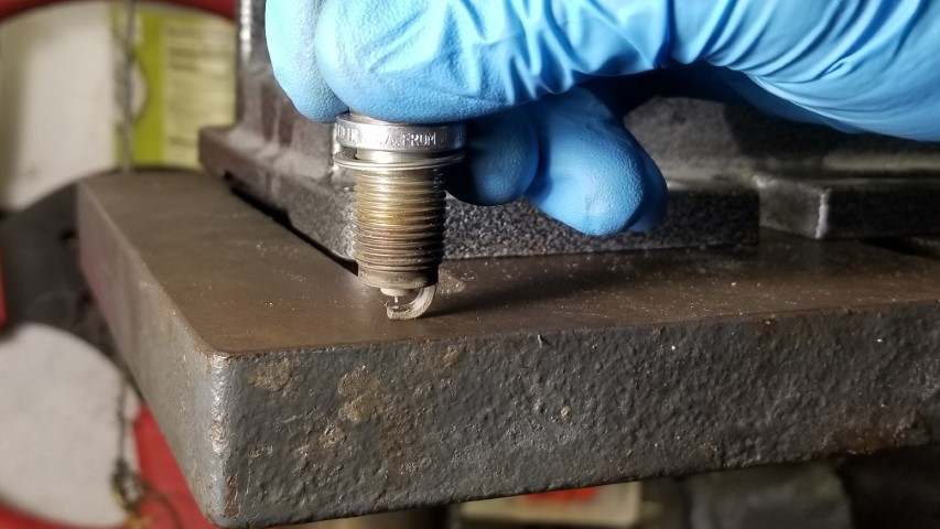 Tapping Spark Plug Ground Electrode On Metal To Close Gap