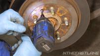 Remove rotor retaining bolt