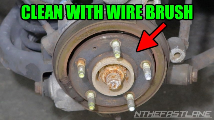 Clean wheel hub with wire brush