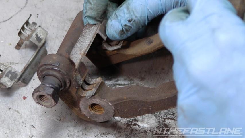 Installing brake clip back into carrier