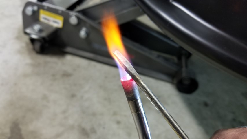 Heating Screwdriver Tip Till Flame Is Or