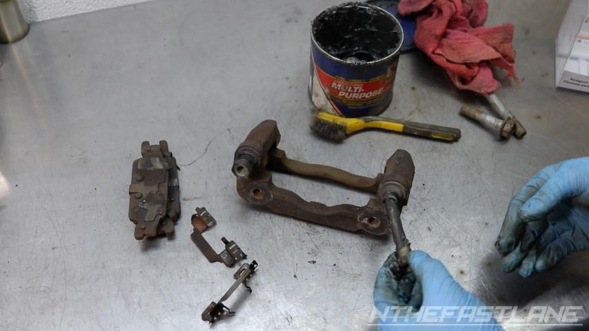 Installing second greased slider bolt
