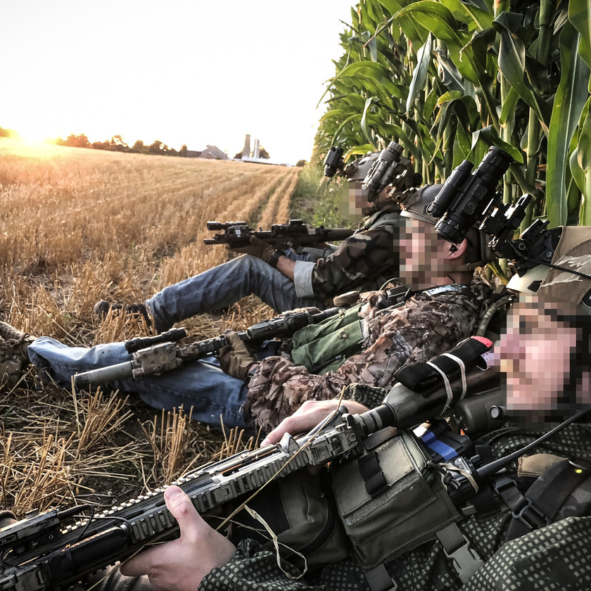 Blackline Simulations Airsoft Milsim - Ruby Echo - Hawaiian shirt liaison team resting in field with NODs and helmets airsoft guns
