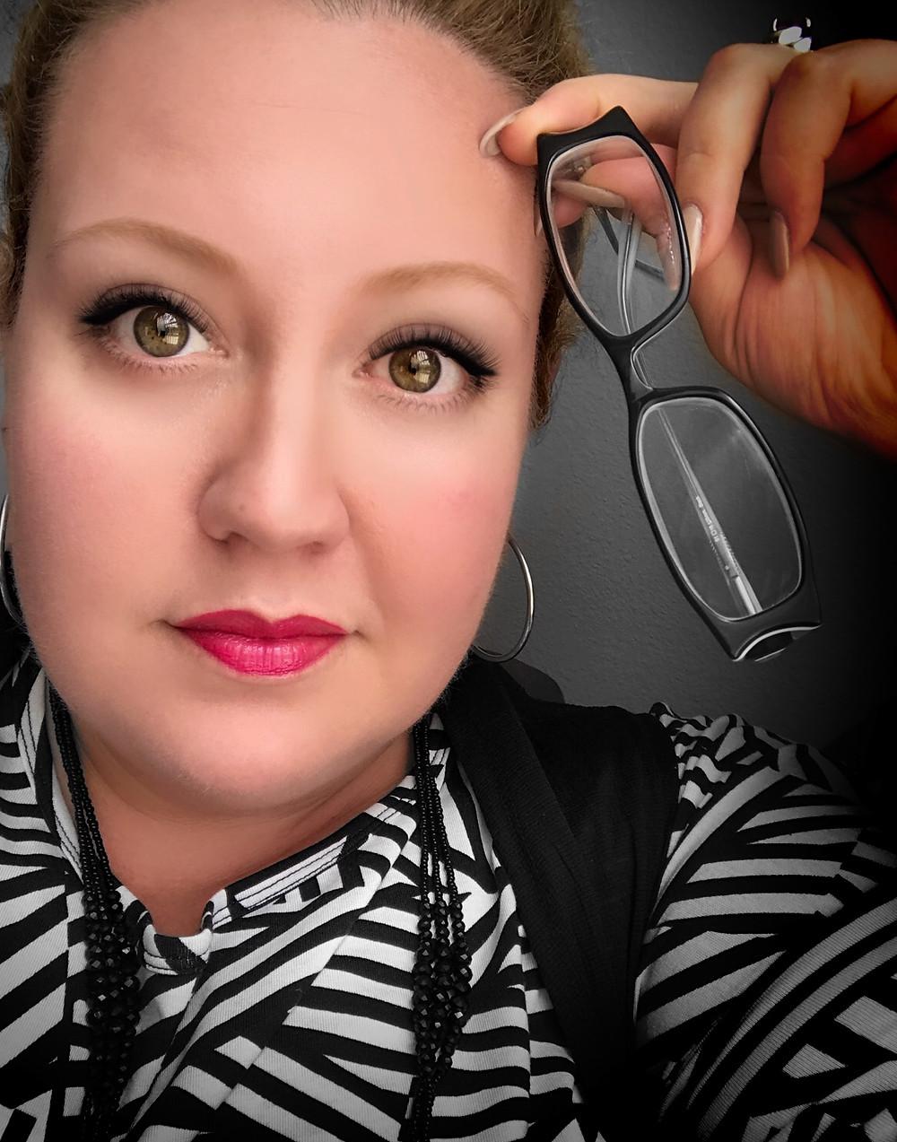 Do I look smarter holding my glasses?