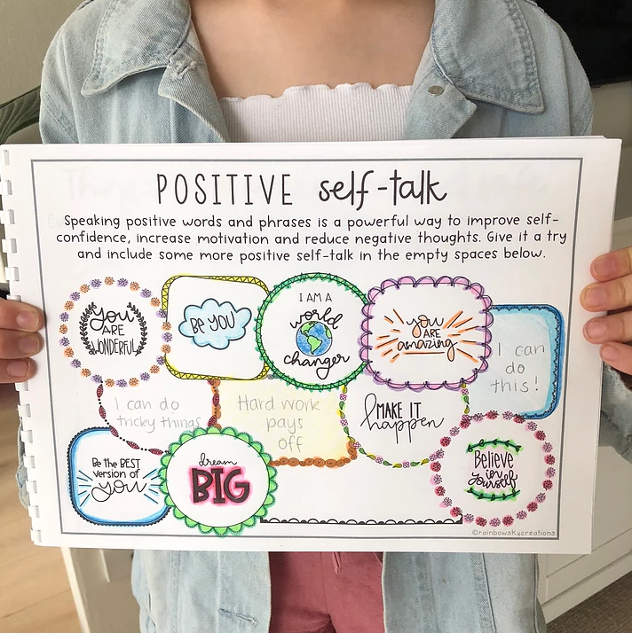 Child with positive self-talk page from wellbeing journal