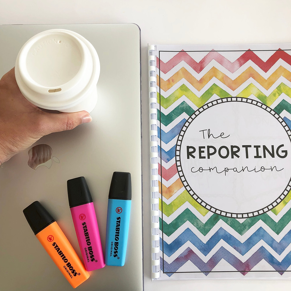 Laptop, highlighters, coffee and report companion