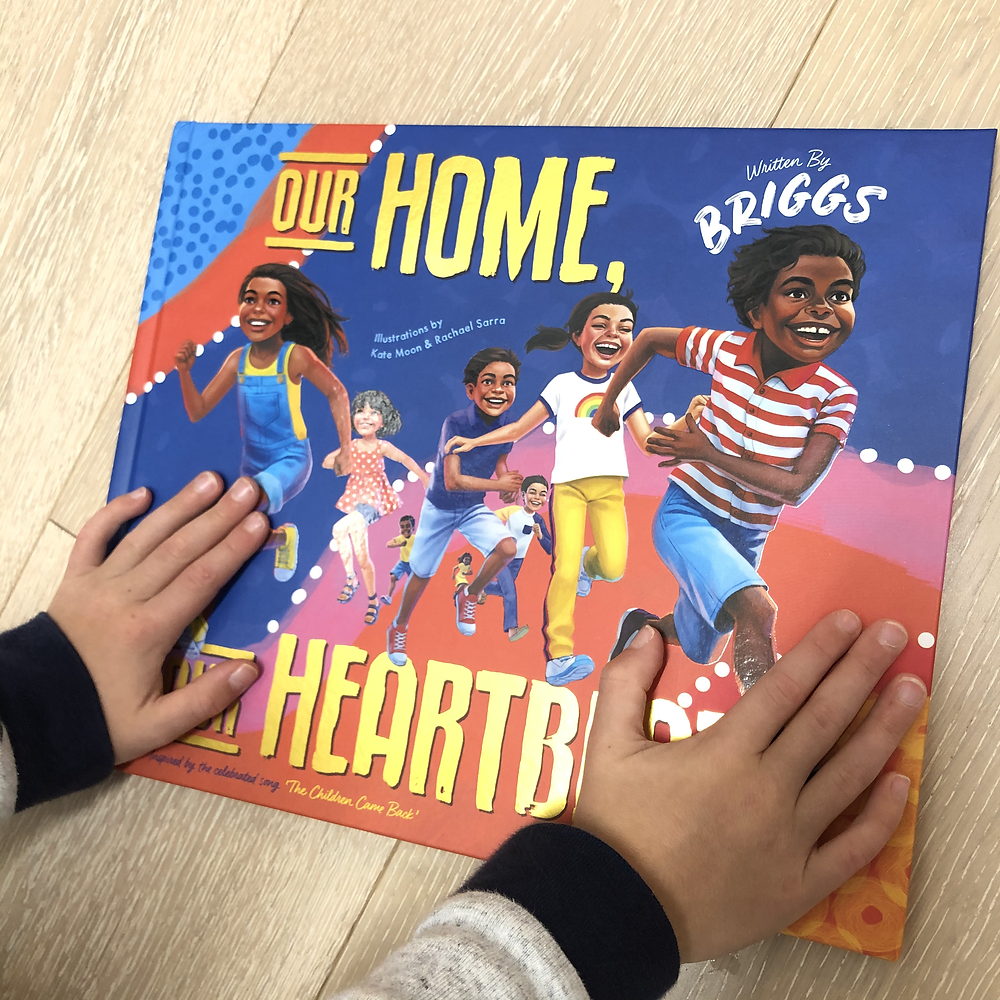 Our Home, Our Heartbeat book with hands