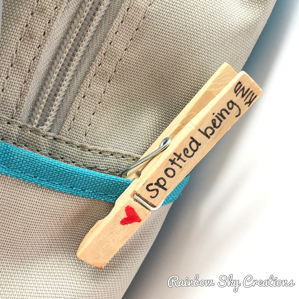 Peg with positive message on school bag