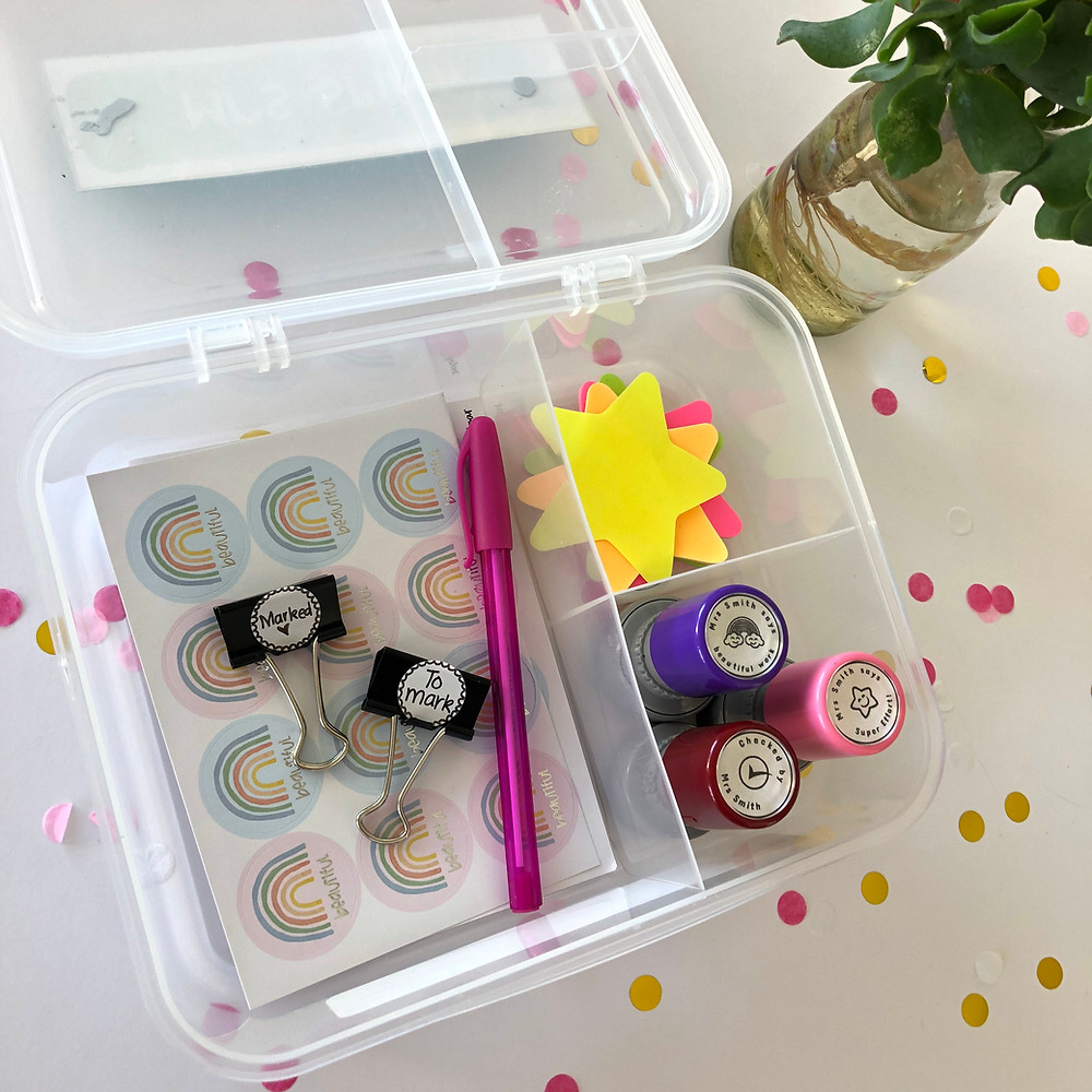 Marking tools such as stickers, stamps and pens stored in a bento lunchbox