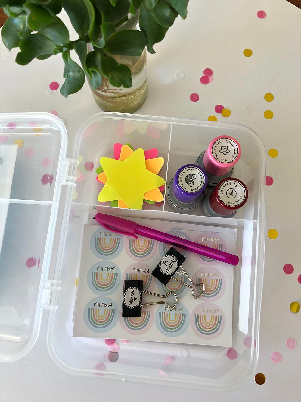 Lunchbox with stickers, stamps and sticky notes to help with productive marking