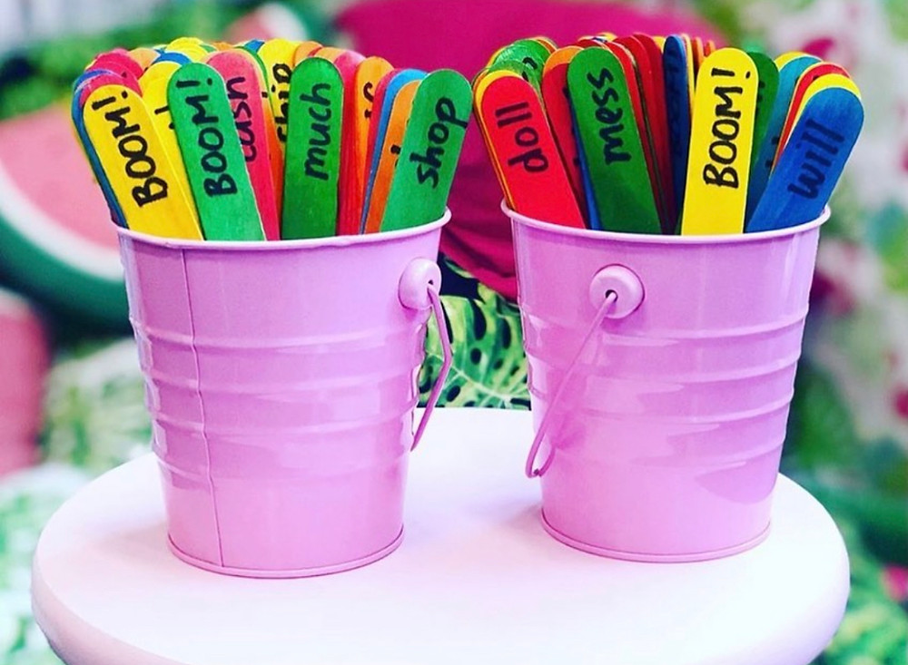 Boom game in pink buckets