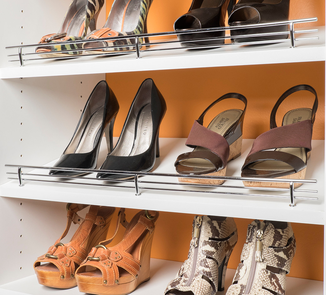Chrome Shoe Fences on White Shelves.jpg