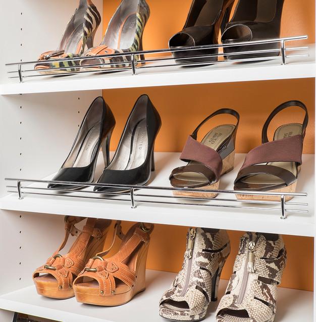 Chrome Shoe Fences on White Shelves.jpg