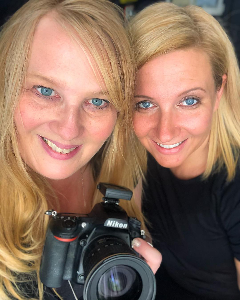 Selfie of Jennifer Heffner, Photographer with her camera and Meg Donnelly, Licensed Massage Therapist
