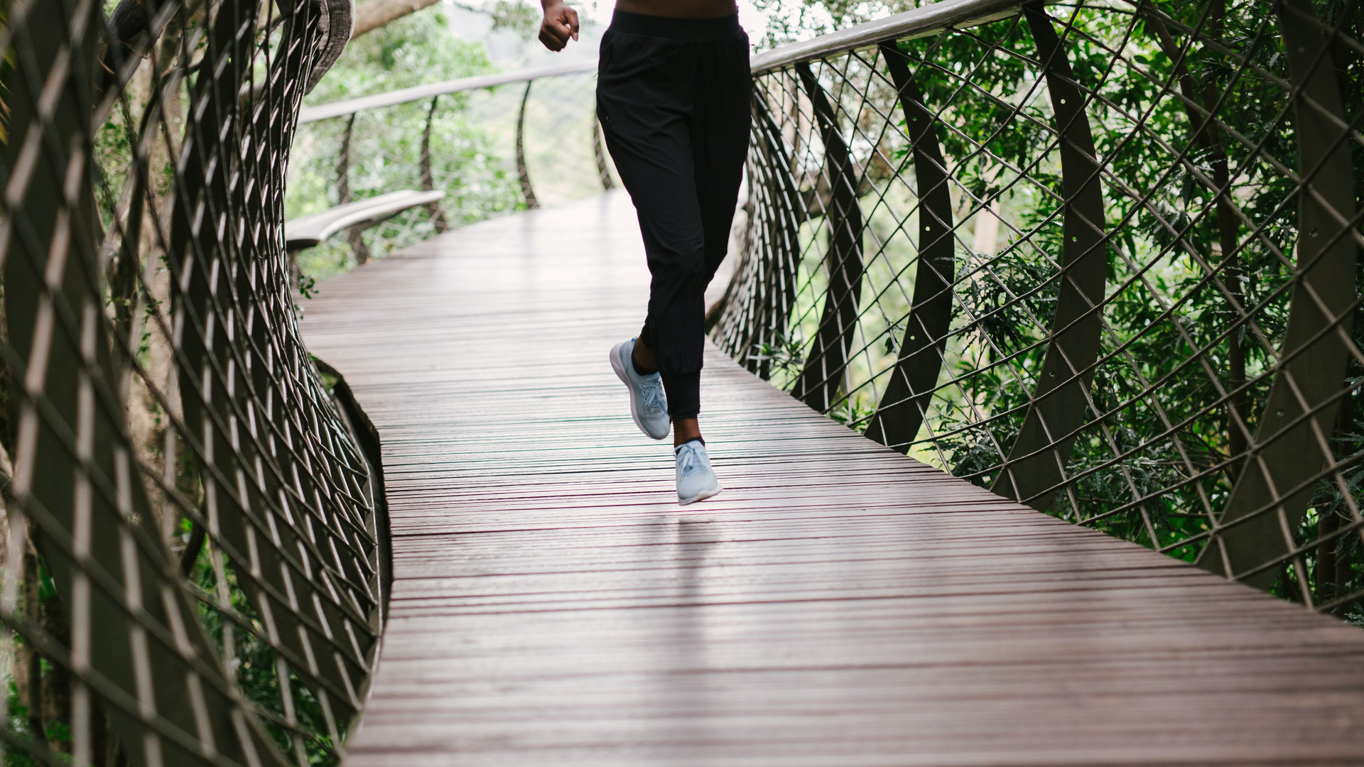 Woman Running Outdoors on Bridge