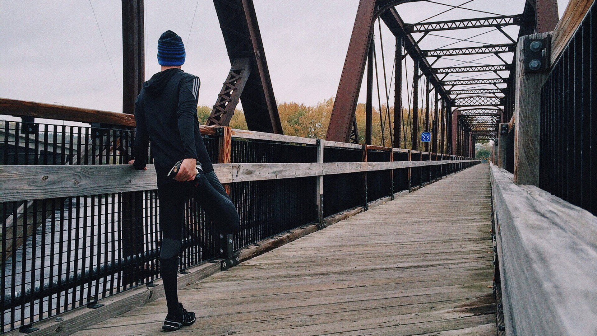 Runner Stretching on Bridge