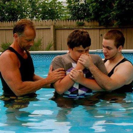 Jonathan baptising Casey.jpg